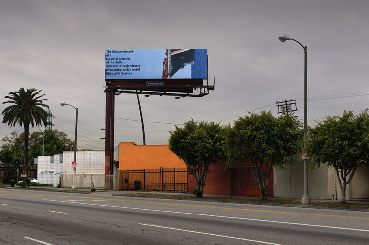 Daniel Joseph Martinez is an art professor at UC Irvine and his billboard marries photography with text. Photo by Gerard Smulevich.