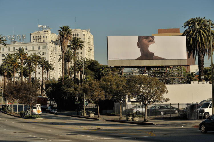 Artist Kori Newkirk stars in his own work here, a startling image that hovers high over Wilshire, near Hoover Street. Photo by Gerard Smulevich.