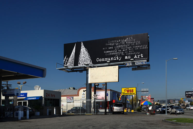 Text and towers dominate Kira Lynn Harris's billboard at La Cienega and Cadillac Avenue. Photo by Gerard Smulevich.
