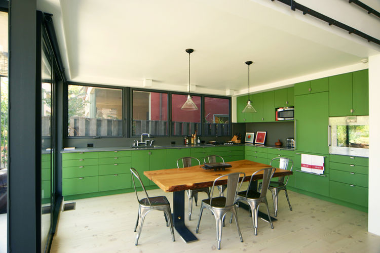 """""""This kitchen cabinets are finished with flat lacquer as none of the laminate colors worked with the house's color/material palette and the client had a bit of an aversion to laminate. The countertops are a material that is used for science lab tops. Very"""