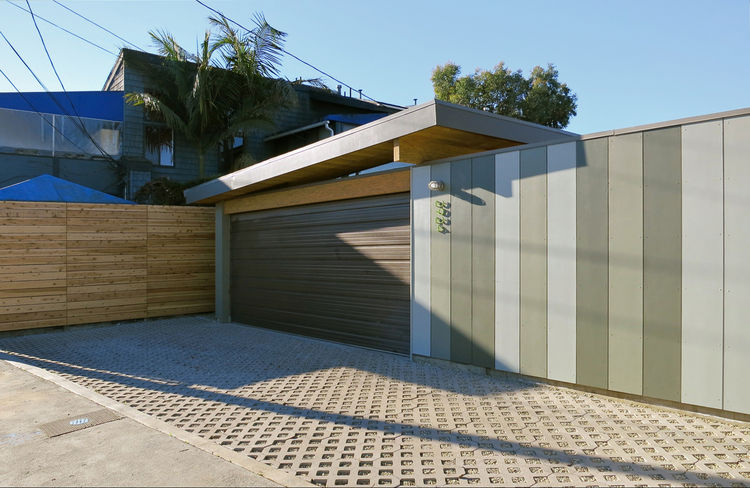Behind the house, Sweet built a garage. He pushed the original wall back to make room for more parking spaces outdoors. Instead of two cars, Borst could now park up to four cars. Sweet also installed permeable pavers so water percolates into the ground in