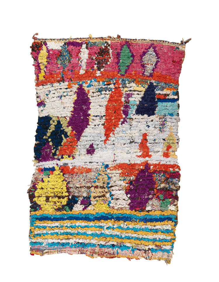 "A 4'6"" by 7' collage of stripes and diamonds, motifs found in traditional Moroccan carpets."