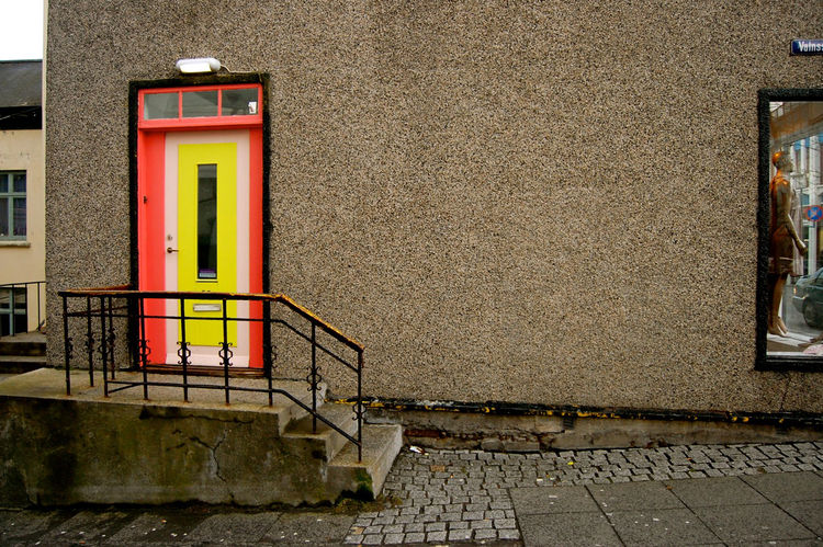 A pink and yellow doorway made a rather boring building remarkable.
