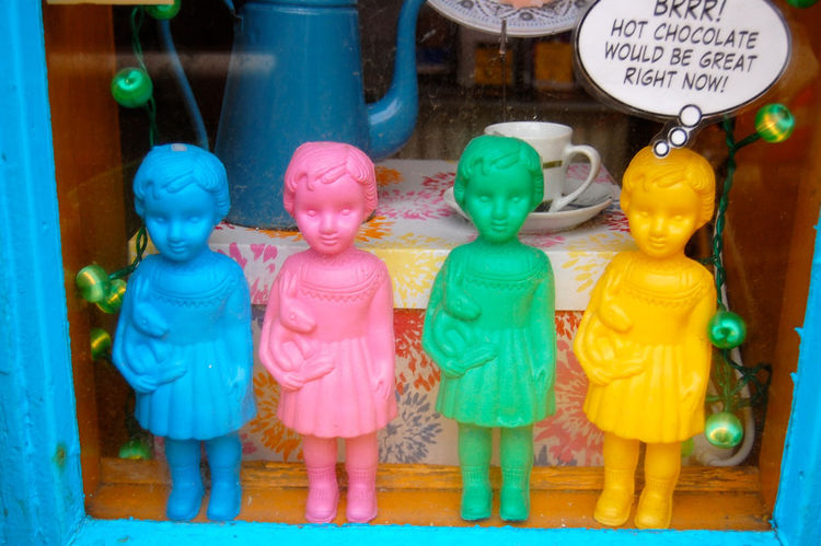 Little plastic dolls in this storefront perfectly illustrate Reykjavik's palette of bright hues.