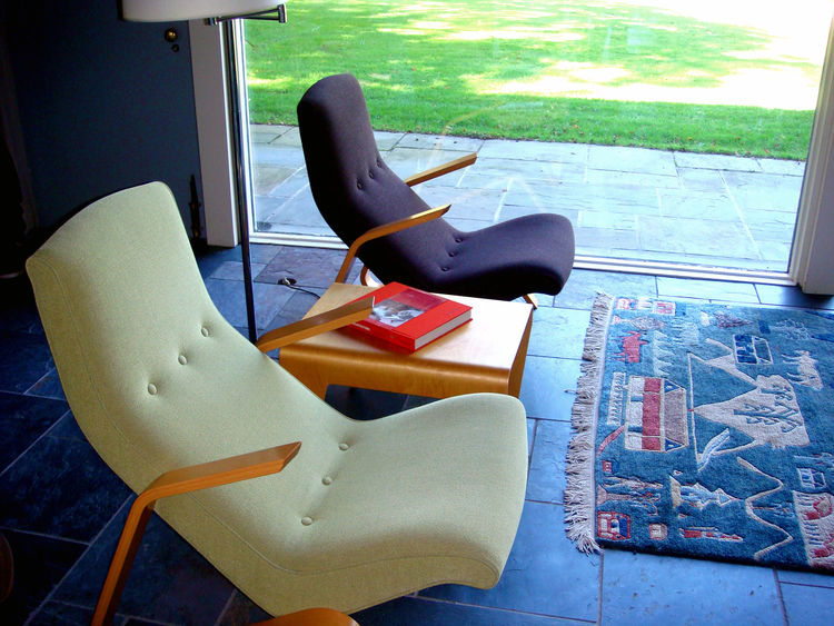 "These Saarinen Grasshopper chairs were recently reupholstered with Knoll fabrics. The bent plywood nesting table between the chairs was designed by Breuer in 1935, is currently produced by <a href=""http://www.isokonplus.com/"">Isokon</a> in London, and was"