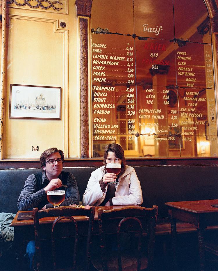 Patrons at A La Mort Subite enjoy a modest glass of Belgian ale.