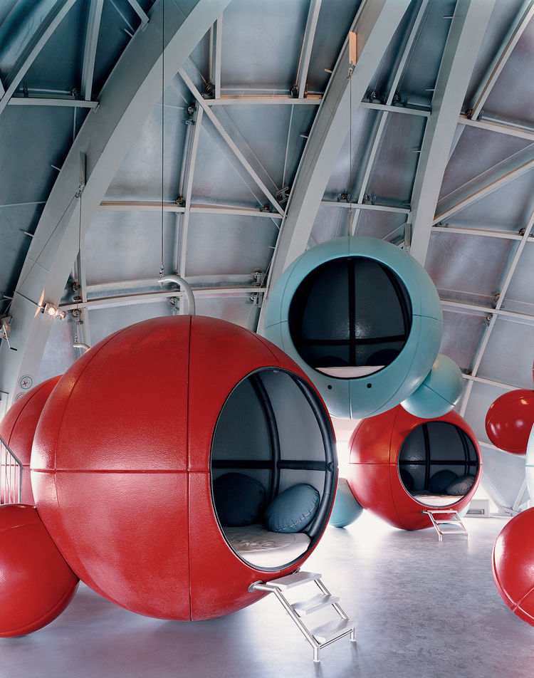 Conix Architecten of Antwerp, Belgium, were responsible for the renovation of the Atomium's interior, which includes these atomlike seating pods.