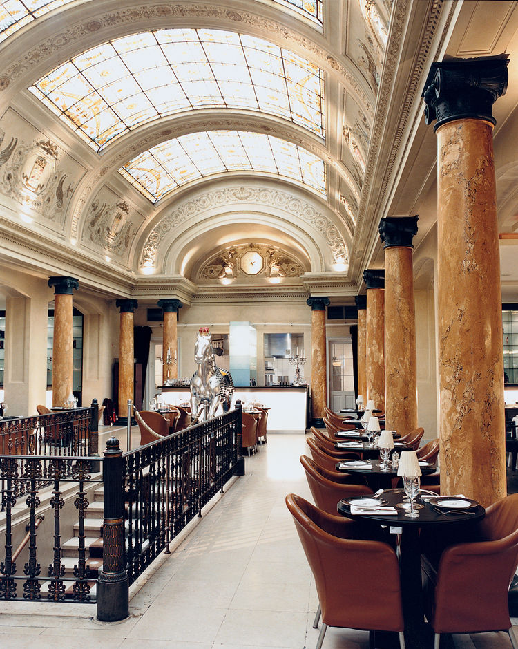 Belga Queen mixes details from the former occupant, a bank, with modern restaurant furnishings.