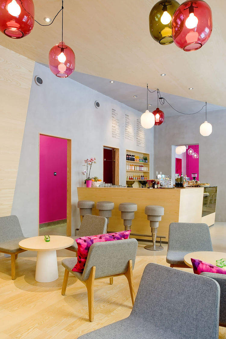 "As you can see from the bright accents of powder blue and Barbie pink, the interior is meant to elicit a strong response. According to Note, owner Michael Toutoungi said that he wanted a space that ""people either love or hate and that nobody is indifferen"