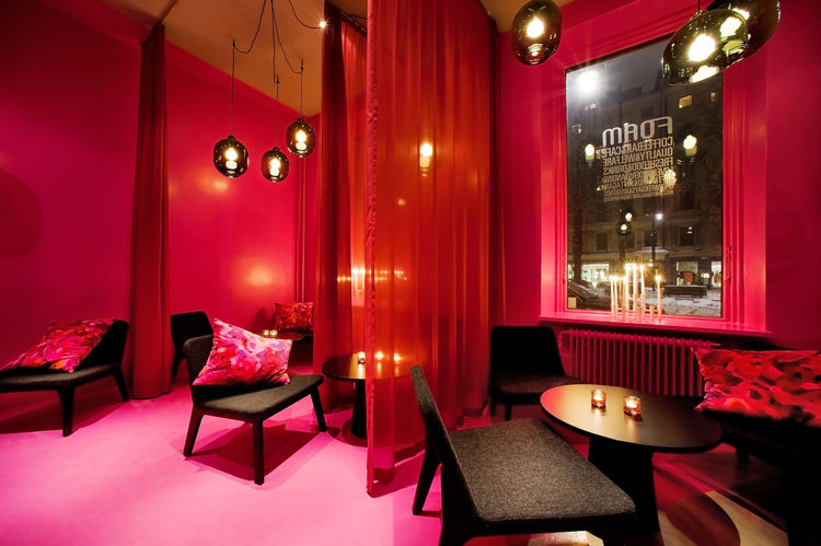 "The side room swathed in red fabric leans more toward the Spanish influence (and it looks a lot swankier that the rest of the cafe). Says Note Design: ""We began searching for extremes, where passion and hate were equally present. Our entrance to the proje"