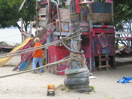 The standard kit of Adventure playgrounds is an assembly of recycled scraps—tires, boards, paint—which the children are allowed to manipulate as they wish, using simple tools. There is usually sand, water, and mud play, and some adventure playgrounds also