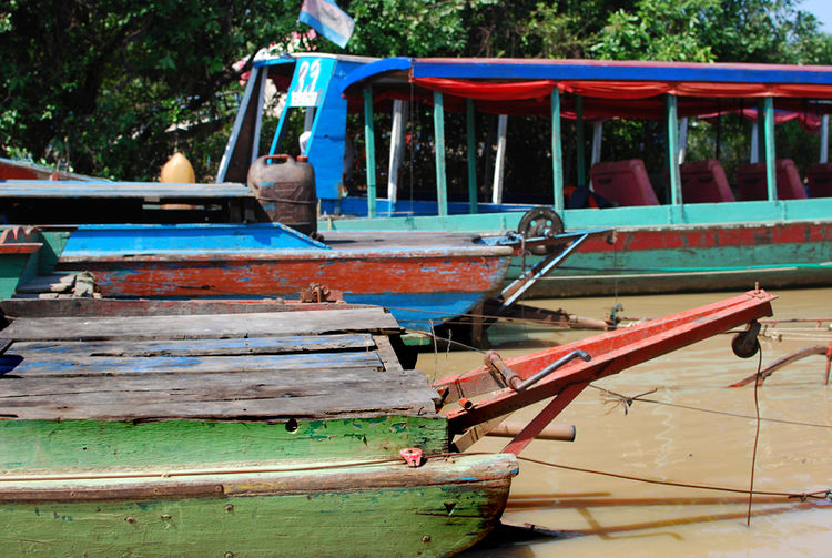 Several of the colorful wooden tourist boats lined up, also known as 'river taxis.' (I rode one of these.)