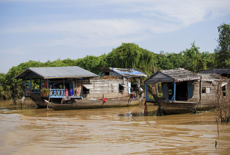 After chatting with my boat guide, I was able to glean that many of these villagers on the Tonle Sap lake are, in fact, not Cambodian -- a few are indeed Khmer households, but a large proportion are ethnic Vietnamese refugees.  Since they are not legally
