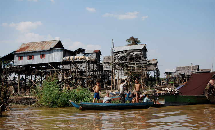 Kompong Phluk is a village of around 100 stilted homes, located on one of the northern-central tributaries of the Tonle Sap lake.  Meandering along the waterway through the village, I watched as men dried fish on mats, women collecting throngs of pink shr