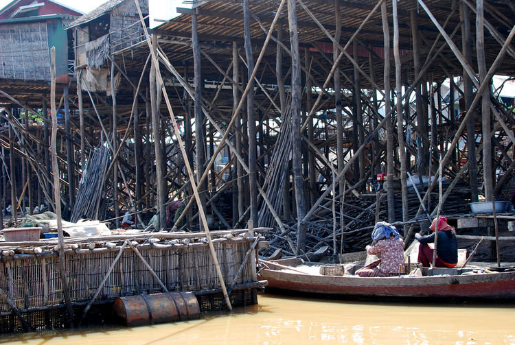 I was lucky enough to be visiting during the dry season, when water levels in the lake are lower and all of the stilted structures below the living areas are revealed.  Many families use the lower areas for storage during the dry season, putting aside fis