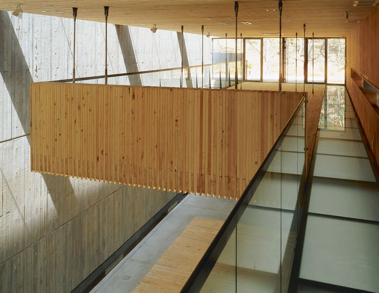 Cho designed the Camerata Music Space and Gallery for the Heyri Art Valley in 2004. Essentially a concrete box, the space contains a hanging structure of horizontally stacked wood, which is directly inspired from a technique used (albeit vertically) in Mo