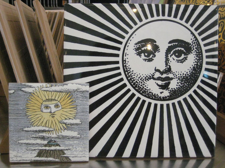 "I'm not generally drawn to Piero Fornasetti's designs but I did love these graphic suns from Ceramica Bardelli. The larger, Fornasettiana, is 8"" x 8"", and the smaller, from the Lunario Del Sole line, is 4"" x 4""."