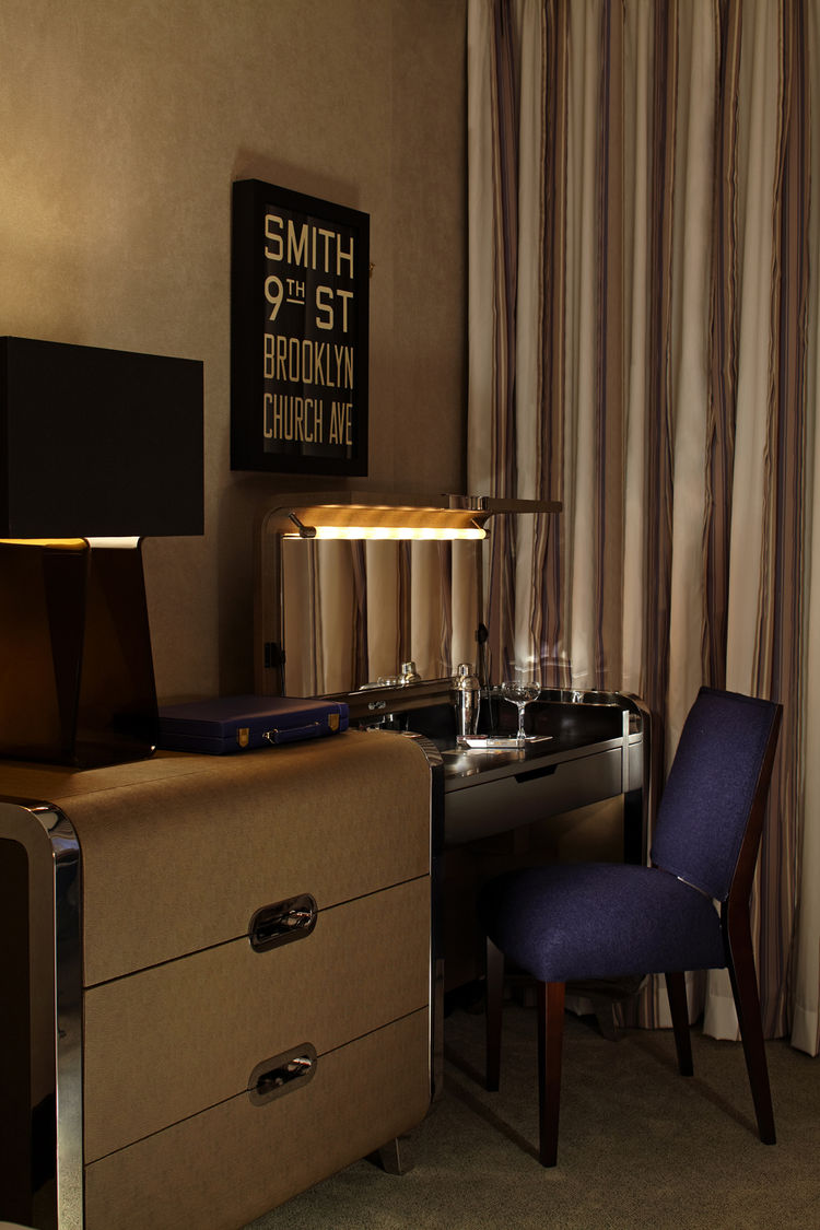 Throughout the hotel, Despont has redistributed preexisting elements—wooden double doors featuring a distinctive barrel-lid motif, a handcrafted mantelpiece, the memorial commemorating members lost in the two World Wars—which, like sudden memories, take v