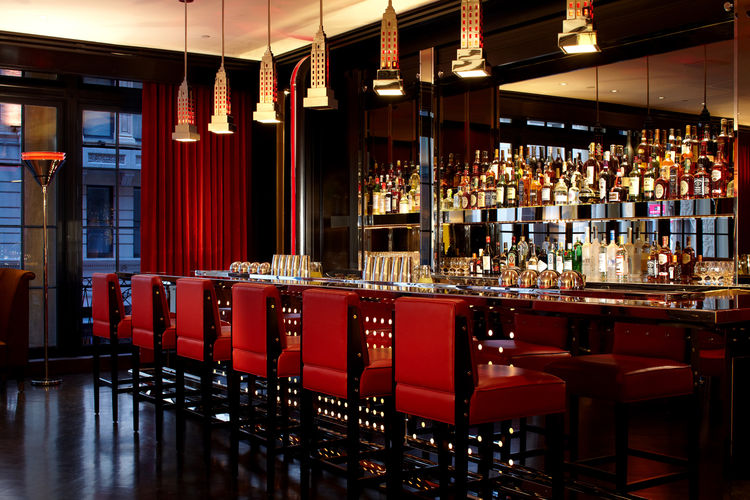"""""""Architecture is about memories, of things we've seen, books we've read, movies—the emotional content is very important,"""" Despont believes. The Lambs Club bar, which overlooks the lobby, was inspired by his memory of Charles Ebbets' famous 1932 photograph"""