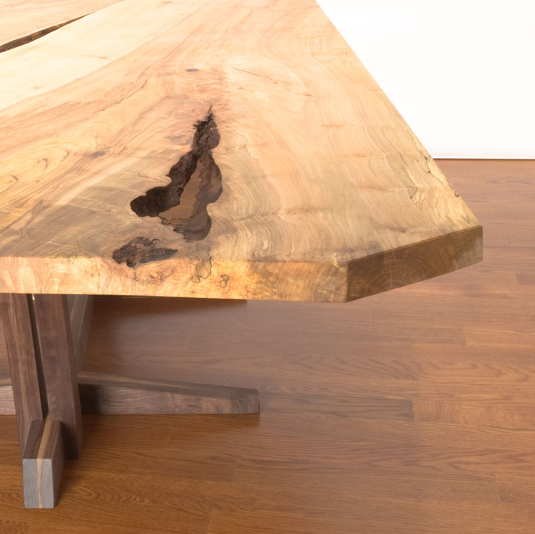 "Canada's <a href=""http://cherrywoodstudio.ca/"">Cherrywood Studio</a>, who designed this table, uses locally-sourced large urban hardwood trees that would otherwise be destined for landfill sites in their furniture pieces."