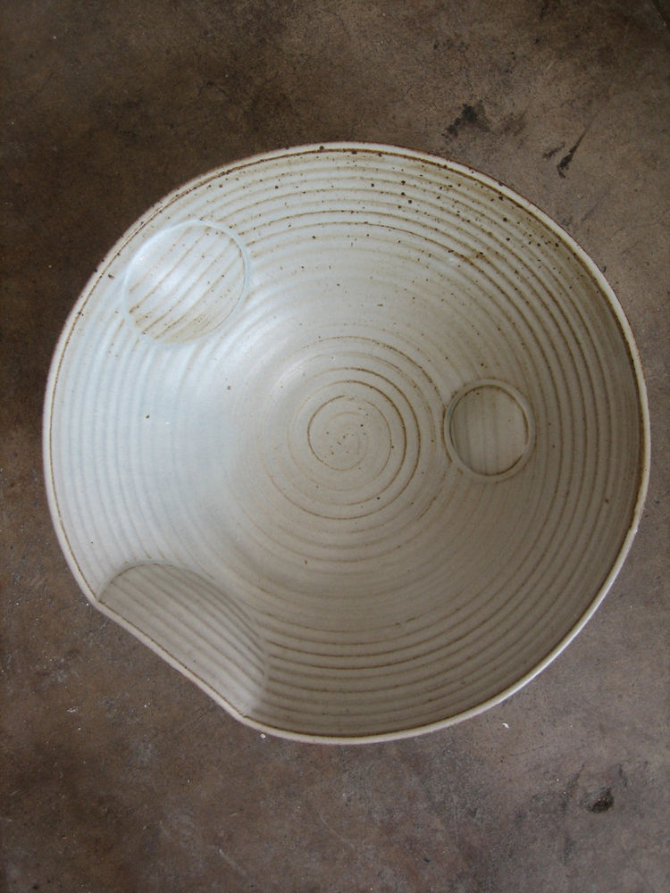 """The Circle bowl series, along with its brethren the Fold, Bead, Stripe and Dot, among others, are a line of what Anton calls """"design-minded wheel-thrown dinnerware—comfy but cool.""""<br /><br />Photo by Lesley Anton."""
