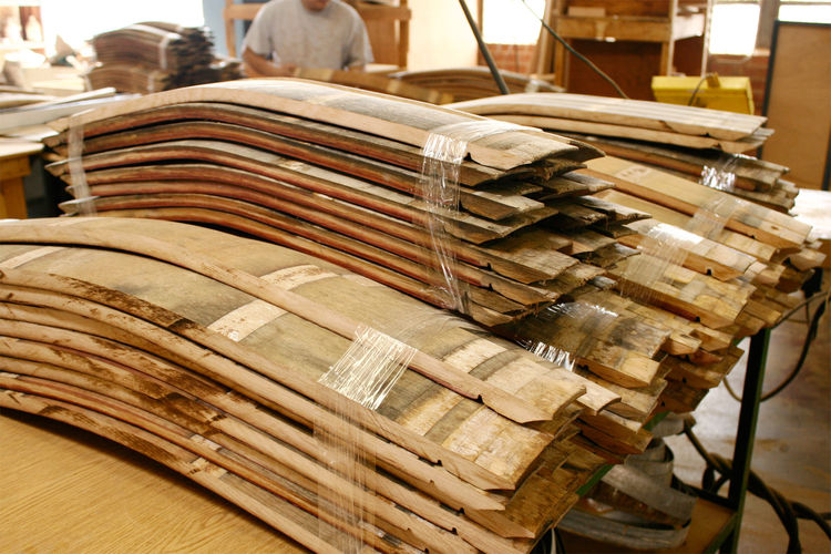 These recycled wine casks will eventually become the fronts of drawers and parts of stools and side tables.