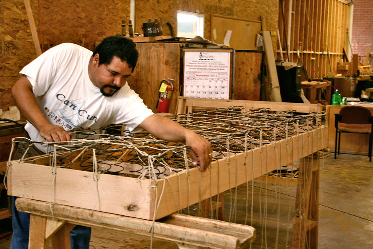 """An """"8-way hand-tied"""" piece is the most intricate seating support systems available—and the most comfortable. At Cisco Brothers, all 8-way support systems are hand tied into a hardwood frame to ensure they won't squeak or rust."""