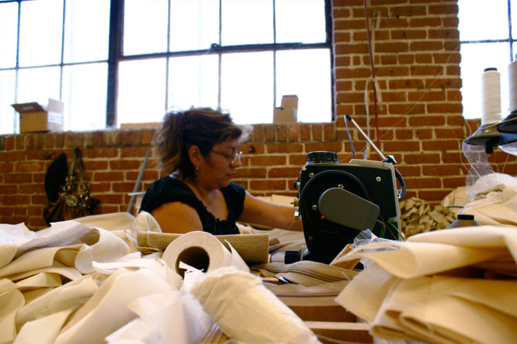 Seamstress at work! All Cisco's fabrics are washed in environmentally friendly detergents.