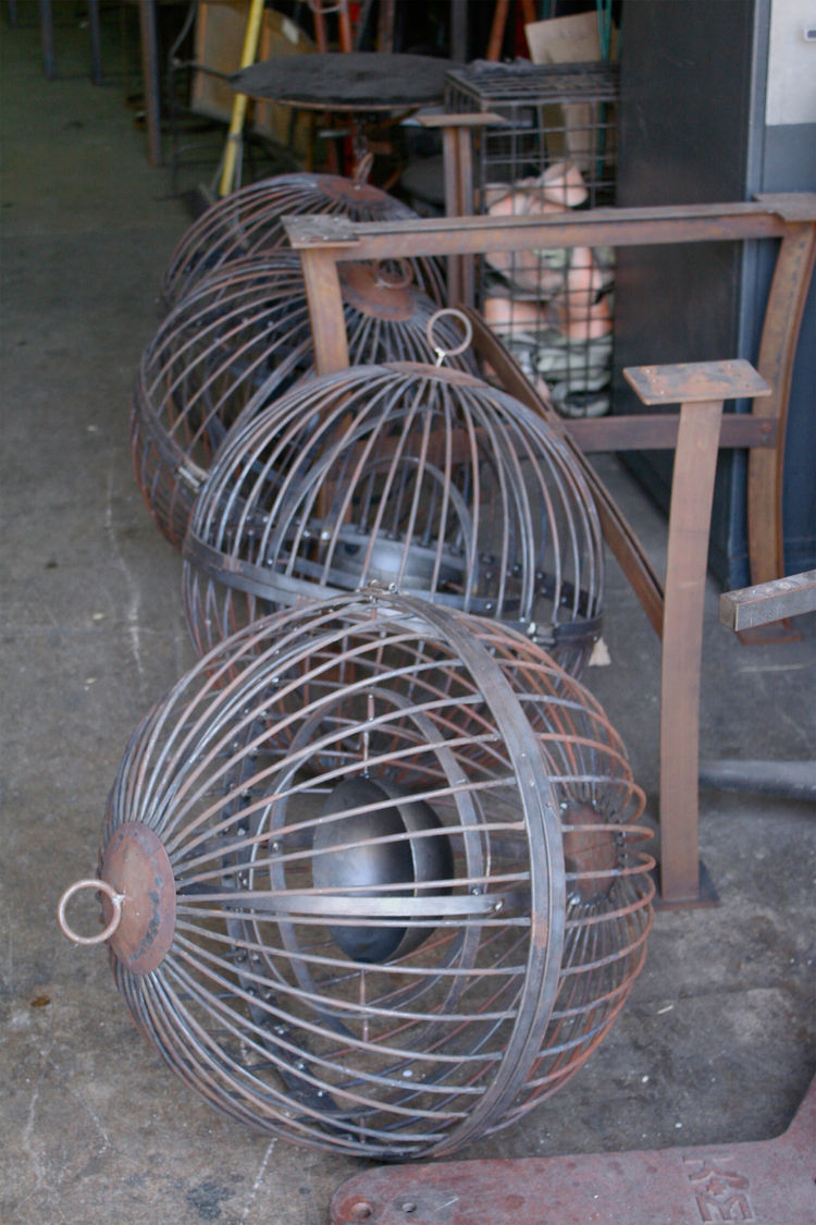 Here are a few bird cage lamps. Welding done on the premises!