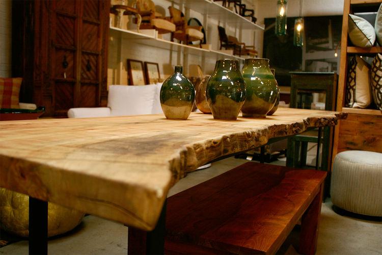 "A gorgeous slab table highlighting the work of <a href=""http://magnoliaceramics.com/MAGNOLIA_CERAMICS_HOME.html"">Magnolia Ceramics</a>,  the company of local ceramicist Warner Walcott."