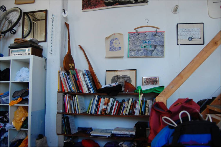 Artwork, books, and musical instruments live in every nook of the workshop.