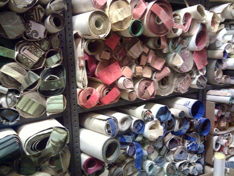 A gorgeously cluttered archive of rolls and remnants can be used by designers or to match old patterns that clients would like to replace. In the factory's previous location in north London, an arsonist was responsible for the destruction of part of this