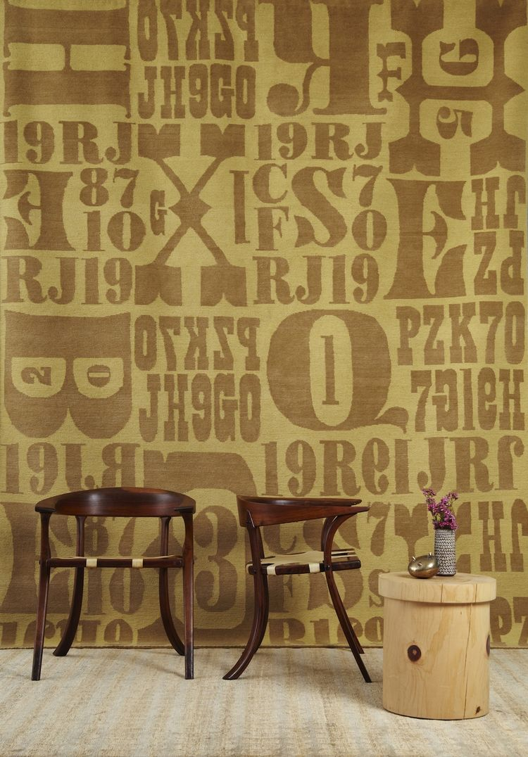 "This rug is called Letterpress, in Camel.<br /><br /><p><em><strong>Don't miss a word of Dwell! Download our </strong></em><a href=""http://itunes.apple.com/us/app/dwell/id411793747?mt=8""><em><strong> FREE app from iTunes</strong></em></a><em><strong>, fri"