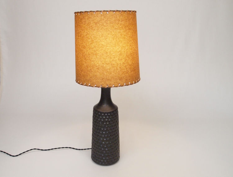 A hand-thrown carved ceramic lamp and shade by Victoria Morris for Commune, $600.