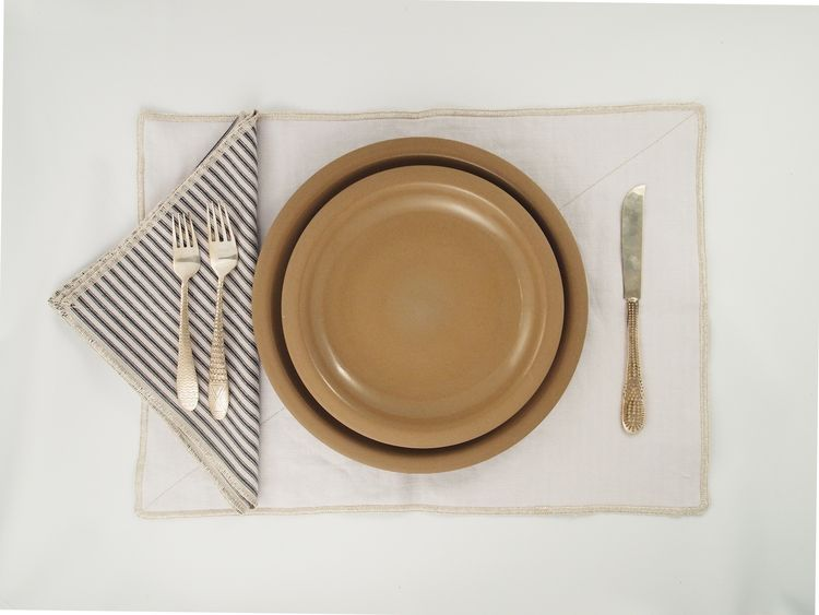 "Commune created these Ticking Table Linens specially for Heath Ceramics. Crafted from 100% cotton ticking and piece-dyed linen with metallic stitching, they're made in Los Angeles by <a href=""http://matteohome.com/"">Matteo</a>."
