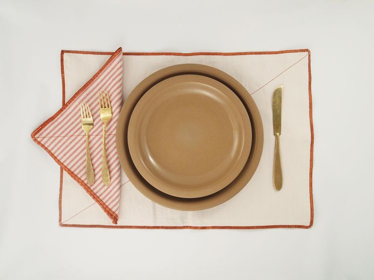 They also come in red. A set of four napkins is $112.00; four placemats, $140.00.