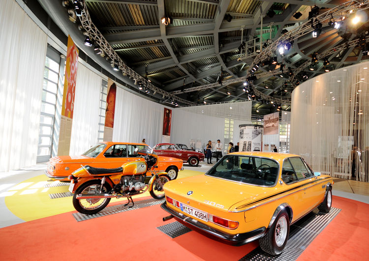 A beautiful example of Mario Bellini's architecture, set against rare BMW motorcars and motorbikes. Notice the limited use of artificial light—Bellini's design takes advantage of the natural sunlight through the 360-degree glass walls.