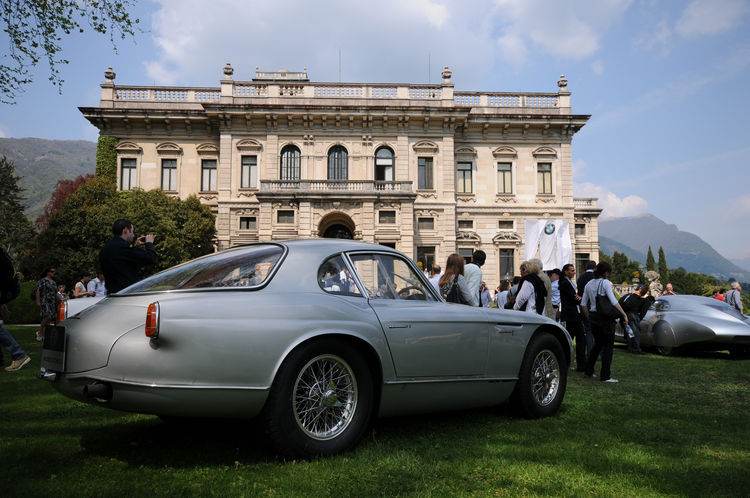 A 1954 Alfa Romeo 2000 Sportiva is framed by Villa Erba. Before the war, the villa was host to extraordinary parties with notable guests, artists and personalities from the political and industrial worlds.