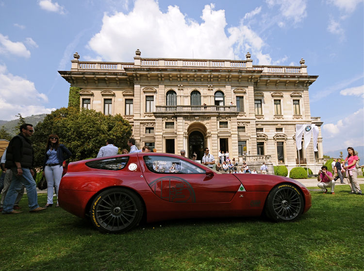 The world premier of the concept Alfa Romeo TZ3 Corsa by design house Zagato commemorates Alfa's 100th Anniversary and their longstanding collaboration. This photograph defines the Concorso—old meets new.