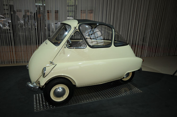 """A statement in economical, sensible and efficient transportation: the BMW Isetta. Its front-opening door and glass """"greenhouse"""" interior gave way to it being known as the """"bubble-car."""" This """"microcar"""" was meant for short-distance travel and stands at a mi"""