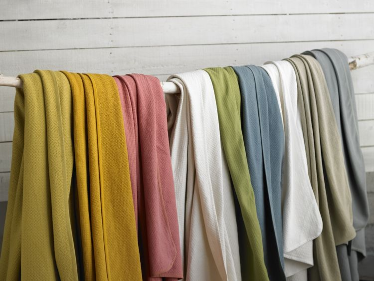 The new Basket Weave Blanket is jacquard woven of pure organic cotton, bound with percale. It's also machine washable.