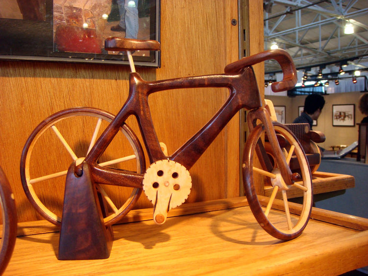 """Steve Baldwin of <a href=""""http://baldwintoys.com/"""">Baldwin Toys</a> creates spectacular wooden heirloom toys for adults and children and has been doing so since 1976. Among my favorites was this handsome road bike. Though based in Omaha, Nebraska, Baldwin"""