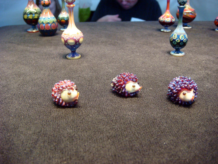 """To cap everything off, a trio of glass hedgehogs by <a href=""""http://www.flameworkglass.com/SiteFiles/SFFG-Main.html"""">Suellen Fowler</a>.<br /><br />Click through the Council's interactive <a href=""""http://americancraftmag.org/timeline/"""">70 year timeline</a"""