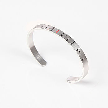 """Craig Arnold's upcycled """"Aperture Cuff"""" can be purchased at <a href=""""http://www.oyemodern.com/designers/re-vision/"""">oyemodern.com</a>."""