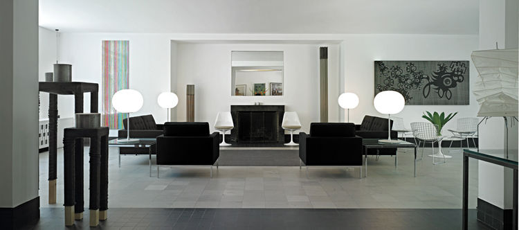 """Interior designer <a href=""""http://www.charfoosdesign.com/"""">Lynda Charfoos</a>, who is based in Bloomfield Hills and sits on the board of governors of Cranbrook, furnished the space with pieces by school alumni like Frances Knoll, Harry Bertoia, Charles Ea"""