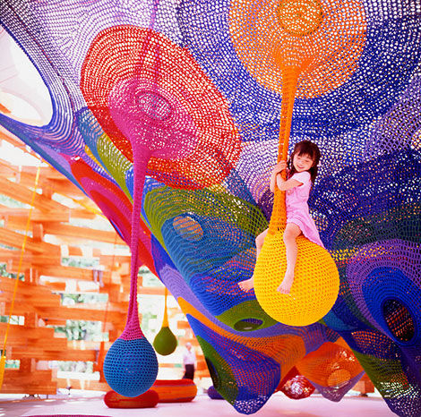 """Playscapes are an amazing but often overlooked venue for artists. <a href=""""http://www.knitjapan.co.uk/features/c_zone/horiuchi/profile.htm"""">Toshiko Horiuchi-MacAdam</a> constructs large, interactive crochet nets that provide a totally unique play experien"""