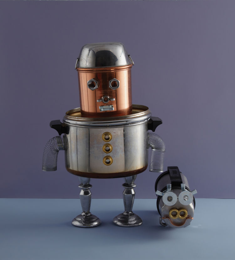 The Pots-and-Pans Robot is one of my favorite projects in the book. It's cobbled together from cookware items past their prime, a couple of candlesticks, and some hot glue.