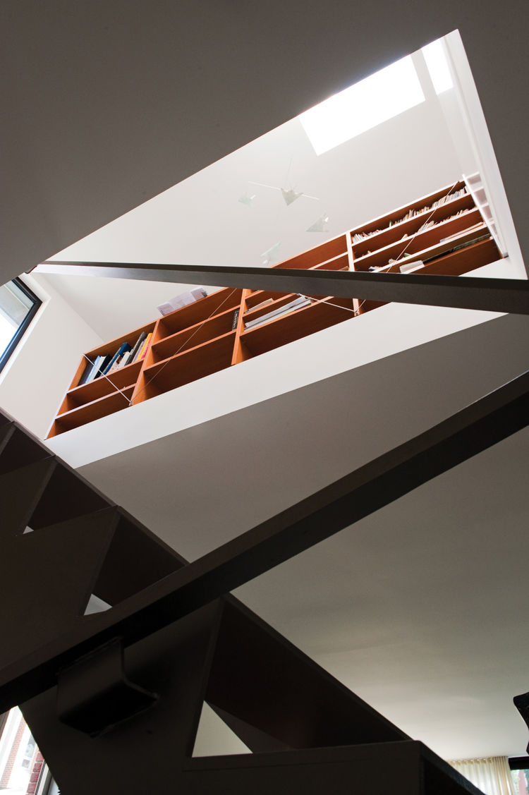 Looking up to the second level of the Brookfield House, where a mobile hangs from the ceiling.