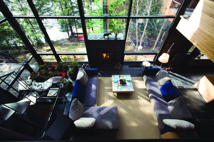 Daoust's living room features an indoor geranium garden, and is centered around a large fireplace.