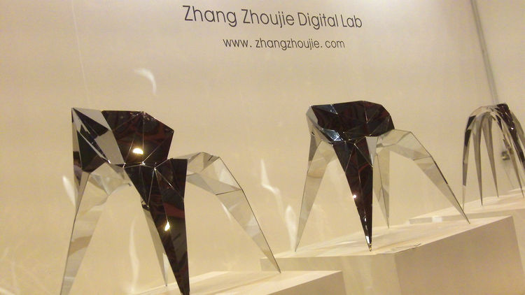 """Shanghai-based <a href=""""http://www.zhangzhoujie.com/"""">Zhoujie Zhang</a> graduated from the Central St. Martins in 2010 and returns to London with a series of faceted chairs cut and folded from a single sheet of mirror-finished steel. Zhang scanned friends"""